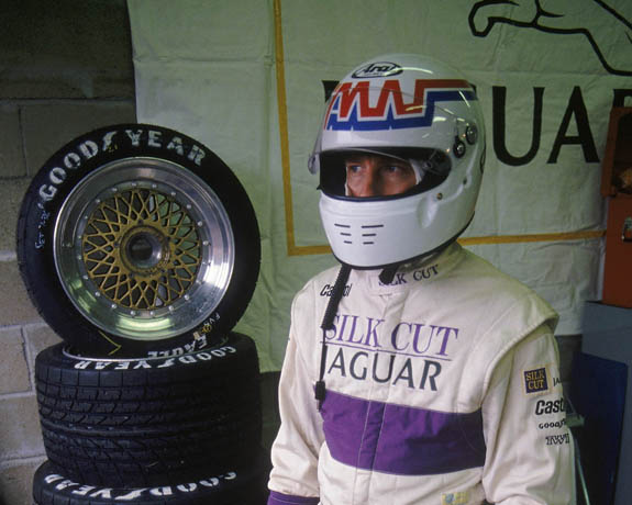 Andy Wallace stands in the paddock at Le Mans in 1991 in front of TWR Jaguar's BBS wheels. (Courtesy of LAT)